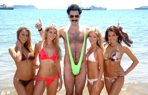 Caption: Borat ( Sacha Baron Cohen ) in his man thing on a beach in Cannes. Credit: Anthony Harvey/Photoshot. All rights reserved.