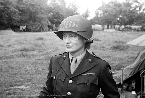 web 5848 28, Lee Miller in steel helmet specially designed for using a camera, Normandy, Unknown Photographer, 1944